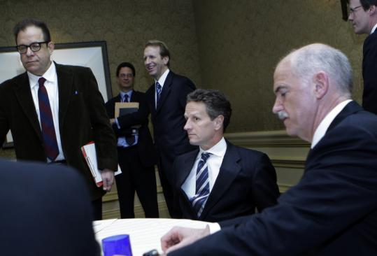 Treasury Secretary Timothy Geithner (center) and Greek Prime Minister George Papandreou (right) met yesterday.