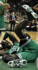 Kevin Garnett hits the floor after fouling the Bucks&#8217; Ersan Ilyasova in the second half.