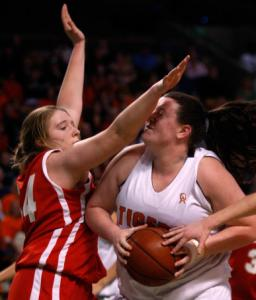 Oliver Ames's Tessa Dern (right) hits a blind alley thanks to Melrose's Annemarie Wiesen.