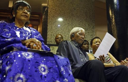 Comments by Winnie Madikizela-Mandela (left), shown with her former husband and his wife, Graca Machel, in Cape Town last month, have been met with outrage in South Africa.