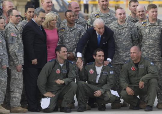 Vice  President Joe Biden posed for pictures yesterday near Tel Aviv with his  wife, Jill, members of a US aviation regiment, Israeli soldiers, and the  nation's defense minister, Ehud Barak.