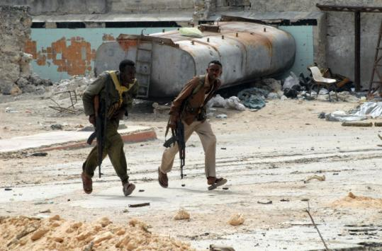 Somali government soldiers (above) have been defending Mogadishu against an insurgent attack for the past two days.
