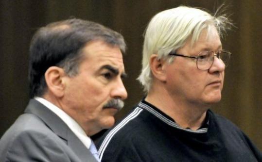 Westfield Sportsman's Club vice president Robert Gorham (right) in court yesterday.