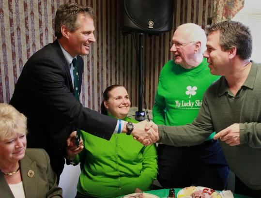 Senator Scott Brown (above) and Governor Deval Patrick warmed up for tomorrow's St. Patrick's Day breakfast in South Boston by attending a roast at the American Legion Hall in Dedham yesterday. Brown shook hands but, unlike Patrick, fired no barbs.