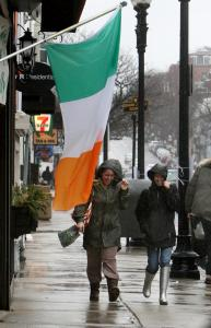 Rain poured on East Broadway in South Boston yesterday, but the parade is expected to proceed regardless of the weather.