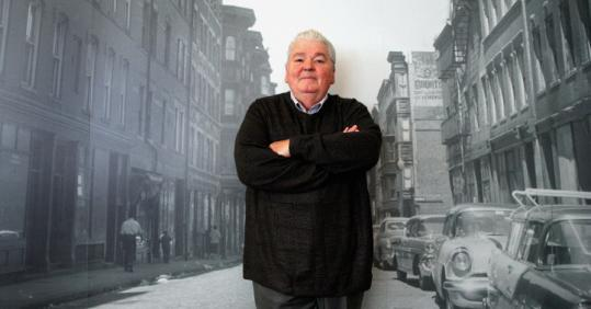 Richard Hartnett stood in front of an old photo of the West End. He wants people to keep the neighborhood&#8217;s story alive.