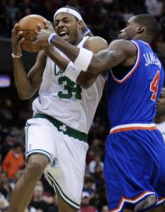 Paul Pierce (34) gets tied up with the Cavaliers' Antawn Jamison on a drive to the basket in the third quarter.
