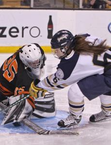 St. Mary's Lynn Sabrina beats Woburn's Meghan Moore for a goal in the second period.