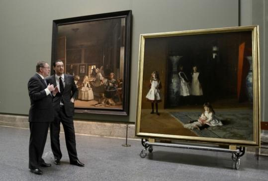 MFA director Malcolm Rogers (left) and Miguel Zugaza, Prado Museum director, admired Velazquez and Sargent's works yesterday in Madrid.