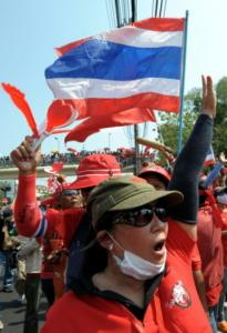 Red-shirted supporters of deposed Thai premier Thaksin Shinawatra protested outside a military barracks in Bangkok.