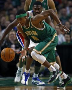 Point guard Rajon Rondo heads upcourt with the ball after a strip of the Pistons' Jason Maxiell (rear) in the first half.