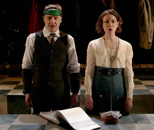 "Brendan McNab (Mr. Zero) and Liz Hayes (Daisy) in a scene from SpeakEasy Stage Company's production of ""Adding Machine.''"