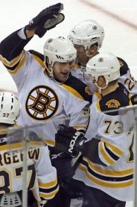 Scoring a goal was a rush for Johnny Boychuk (center), who celebrated with Patrice Bergeron, Michael Ryder (73), and Mark Recchi.