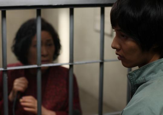 Kim Hye-Ja (left) plays a mother who tries to clear her son (Bin Won) in a murder case.