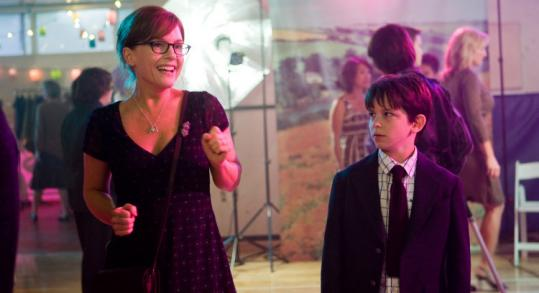 """Zachary Gordon stars in """"Diary of a Wimpy Kid'' with Rachael Harris as his mother, here at a mother-son school dance."""