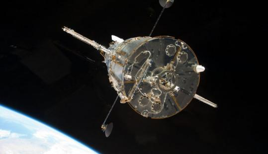The Hubble Space Telescope as seen from the space shuttle after it was released from its final repair.
