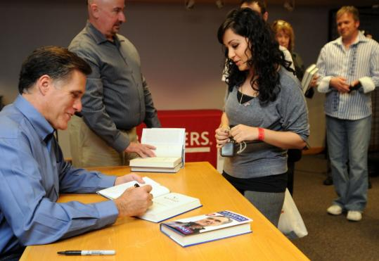 Mitt Romney, former governor of Massachusetts, signed a copy of his new book, ''No Apology,'' for Nuha Kurdistani Sarraj at a bookstore in Phoenix.
