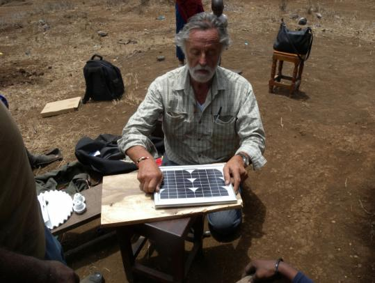 Robert Lange, a retired Brandeis University professor, prepared a solar power unit to be installed on a hut in a T