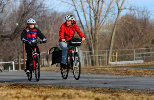 Lauren Hefferon (right) of Arlington rides on a bike path with her daughter, Valentina Rugiero, 10, to her school in Cambridge.
