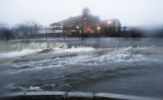 A street next to the Moody Street dam, on the Charles River, was flooded as heavy rains pounded the region. The Charles River Museum shut down after being flooded with 8 inches of water.