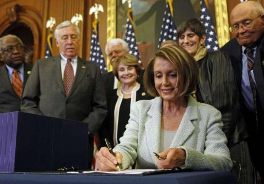 Surrounded by happy Democrats, House Speaker Nancy Pelosi signed the Senate Health Reform bill yesterday.