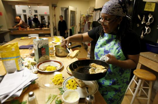 Evelyn Moore prepared a weekly community dinner at Jamaica Plain Cohousing March 12.