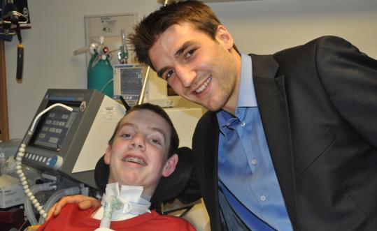 Norwood hockey player Matt Brown, who has a broken neck, had a special linemate yesterday — Patrice Bergeron.