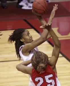 Florida State's Jacinta Monroe soars past St. John's Joy McCorvey to bank home the winning shot in overtime.