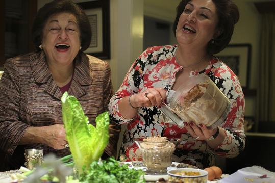 Caroline Ganjei (right) and her mother, Margrit Jacobson, share a laugh and the making of Iranian charoset for the Passover meal.