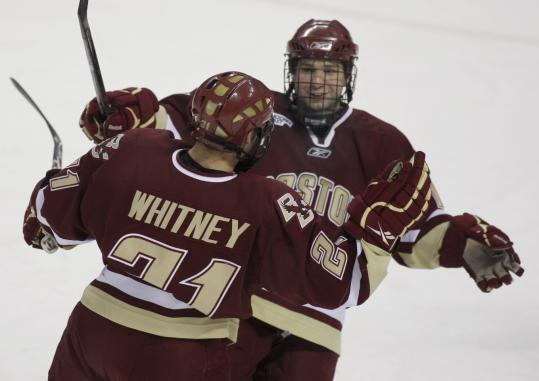 Boston College's Joe Whitney (right) congratulates brother Steven for his goal in a game against Providence.