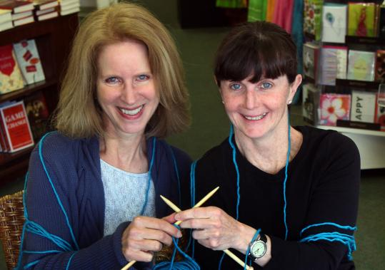 Lee Van Kirk (left) and Kathleen Mitchell organized the knit-a-thon at Wellesley Booksmith that will also include a charitable book fair benefiting Women of Means.