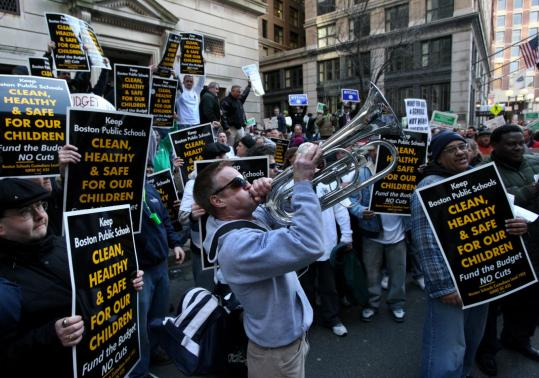 Tom McAuliffe blew a horn yesterday with other protesters outside the School Committee meeting downtown.