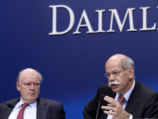 Cerberus Capital  Management chairman John Snow (left) listened in May 2007 as  DaimlerChrysler chief executive Dieter Zetsche said the company would  hand control of the struggling automaker to Cerberus after a nine-year  investment in the company.