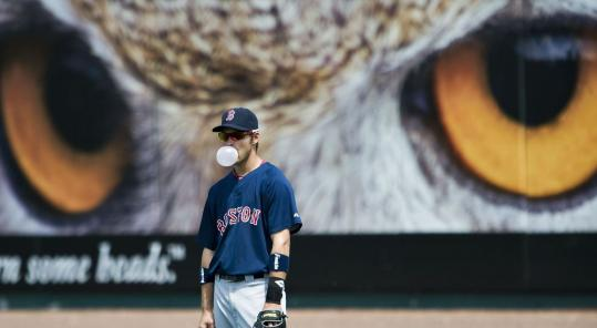 Red Sox outfielder Josh Reddick seems unfazed by an imposing set of eyes watching his every move during yesterday's game.
