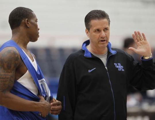 Freshman Eric Bledsoe (left) has been a key element of the equation as coach John Calipari led Kentucky to the Sweet 16.