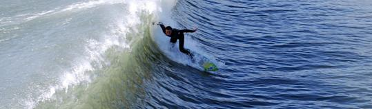 A shortboarder finds a wave off Cowell's Beach in Santa Cruz, where surfing is a year-round activity.