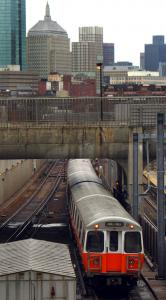 An MBTA train left Ruggles Station on the Orange Line, which now has wireless telephone service.