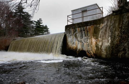 Cracks were visible in the holding wall of the Norton Reservoir Dam on Friday. Deemed structurally unsound, the dam has gone uninspected since 2006, as have others.