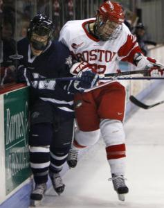 BU's Ross Gaudet checks New Hampshire's Dalton Speelman into the boards during a January game at Agganis Arena in Boston.