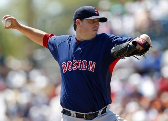 Newly acquired starter John Lackey has no problem sliding into the No. 3 position behind Josh Beckett and Jon Lester.