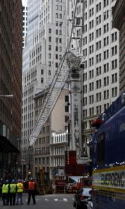 Mechanics and engineers yesterday righted a crane that struck a New York City high-rise Saturday.