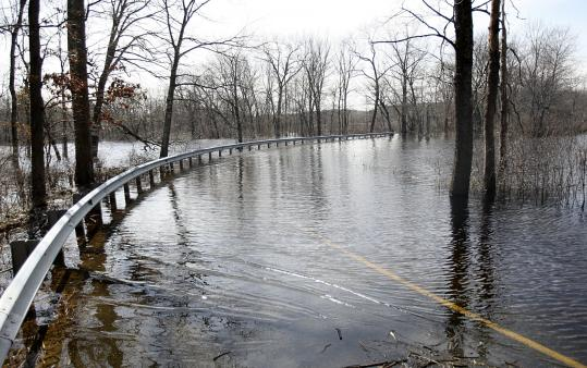 Water Row in Sudbury was still closed yesterday from previous flooding. With more rain expected, Governor Deval Patrick said emergency officials would keep close watch on several rivers in the eastern part of the state, including the Merrimack, Sudbury, Shawsheen, and Concord rivers.
