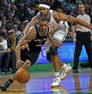 The long arms of Rasheed Wallace are no match for George Hill, who scored 15 points.
