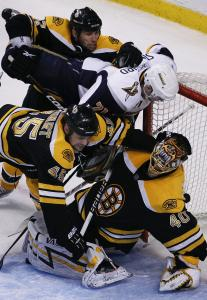 Bruins goaltender Tuukka Rask bent over backward to keep Drew Stafford and the Sabres at bay, with help from Steve Begin and Mark Stuart in the second period. Rask did not allow a goal and made 19 saves in relief of Tim Thomas.
