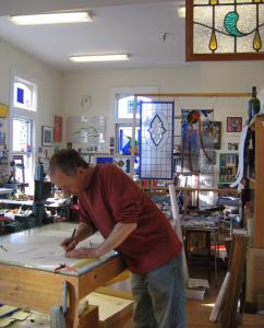 Chris Jeffrey makes and sells stained-glass art at Studio Place Arts.