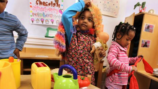 Four-year-olds Nevaeh Martin (right) and Jennifer Dos Santos played at College Bound Dorchester, rated as one of the state's best school readiness programs.