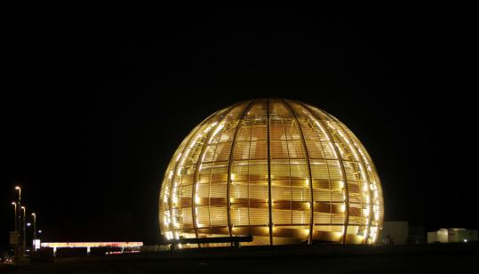 The globe of the European Organization for Nuclear Research was aglow yesterday in Geneva after scientists conducted high-energy, atom-smashing experiments.