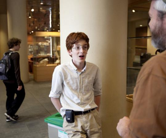 Colin Carlson, 13, with his mentor at the University of Connecticut, Tobias Landberg, after the teen aced a test.