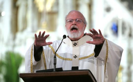 """God is trying to get our attention,'' Cardinal Sean O'Malley said to priests at the Cathedral of the Holy Cross yesterday."