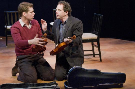 "Michael Kaye (left) and Benjamin Evett play musicians in New Repertory Theatre's production of Michael Hollinger's play ""Opus.''"